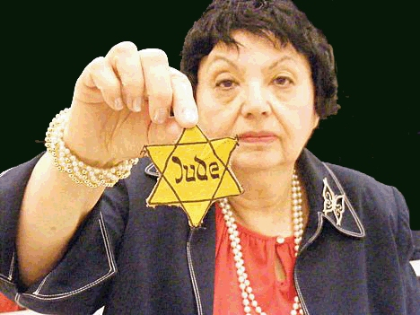 Holocaust survivor Inge  Auerbacher holding the star that she wore in the Terezin concentration camp as a child.