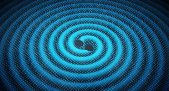 This is an artist's conception of two merging black holes and the gravity waves they generate.
